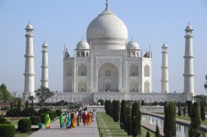 AGR Agra - Taj Mahal panorama with watercourse and indian visitors after sunrise 3008x2000